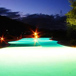 Piscina-esterna-notte-Hotel-&-Resort-Sa-Rocca